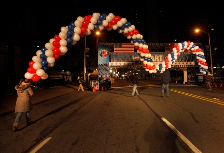 The ballon arch is put into place at the finish line at the 38th Annual Detroit Free Press/Talmer Bank Marathon in Detroit on Sunday, Oct. 18, 2015